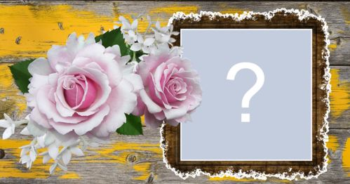Photo frame with roses and wooden background with shades of yellow. Add a photo!
